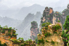 Amazing view of narrow natural wall of rock Avatar Mountains. Amazing view of narrow natural wall of rock named the Natural Great Wall in the Tianzi Mountains stock photo
