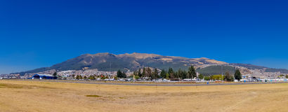 Amazing view of natural mountain and city on the slopes. Sunny and nice day at Parque Bicentenario in Quito, Ecuador Stock Image