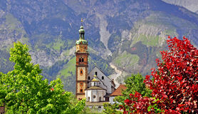 Amazing view of an old bell tower with mountains on background Royalty Free Stock Images