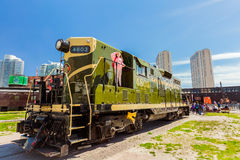 Amazing view of old style retro diesel train with little girl looking up in down town district area on sunny weekend day. Toronto, Ontario, Canada, down town Royalty Free Stock Photos