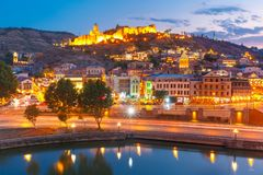 Narikala and Kura river at night, Tbilisi, Georgia. Amazing view of Olt town with Narikala ancient fortress, St Nicholas Church and Kura river in night Royalty Free Stock Photography