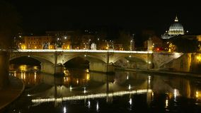 Amazing view over River Tiber in Rome by night with Vatican and Saint Peters Basilica. Videoclip stock footage
