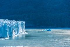 Amazing view of Perito Moreno glacier, blue ice burg glacier from peak of the mountain through the aqua blue lake in Los Glaciares. National Park, Santa Cruz stock photo