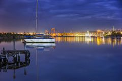Yacht and city lights water reflection royalty free stock image