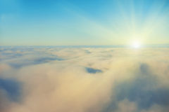 Amazing view from plane on the sky. Sunset sun and clouds stock image