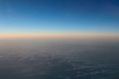 Amazing view from plane on the sky, sunset sun and clouds Stock Photo
