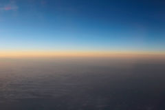Amazing view from plane on the sky, sunset sun and clouds Royalty Free Stock Images