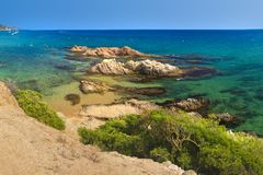 Amazing view on Platja de Santa Cristina in Lloret de Mar, Costa Brava, Spain. Rocks in turquoise water on summer sandy beach. In mediterranean. Paradise lagoon stock image