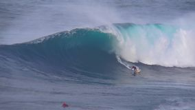 Amazing 4k view on professional surfer riding performing stunts huge turquoise blue foamy waves in deep ocean seascape. Amazing view on professional surfer stock video