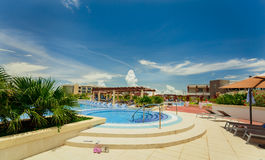 Amazing view of Pullman hotel, inviting cozy stylish swimming pool and grounds on sunny day Royalty Free Stock Images