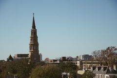 Amazing view from a rooftop of a hip trendy city town with tall church steeple in the midst. Amazing view from a rooftop of a hip trendy apartment building royalty free stock photo