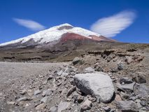 Amazing view of snow capped Cotopaxi volcano, Ecuador. Amazing view of snow capped Cotopaxi volcano with clear sky and clouds like wings, Ecuador Stock Image