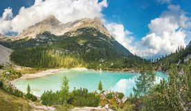 Amazing view of Sorapis lake Lago di Sorapis Dolomites, Italy. Amazing panorama of Sorapis lake Lago di Sorapis Dolomites, Italy royalty free stock photos
