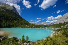 Amazing Sorapis Lake. Amazing view of Sorapis lake with unusual color of water. Lake located in Dolomite Alps, Italy royalty free stock photos