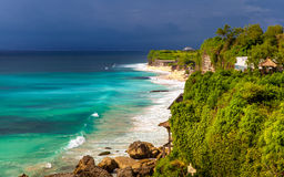 Amazing view of steep cliff and ocean at Tropical island Bali, Indonesia Stock Photos