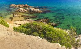 Amazing view on summer spanish beach of Platja de Santa Cristina on clear day. Beach in Lloret de Mar, Costa Brava, Spain. Vacation on Mediterranean sea stock photo