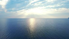 Amazing view sunlight reflecting on sea surface. Drone view blue sea on skyline. Amazing view sunlight reflecting on smooth sea surface. Drone view golden stock footage