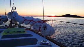 Amazing view of sunset from yacht deck sailing in sea. 4K stock footage