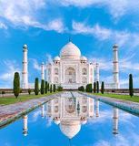 Amazing view on the Taj Mahal in sun light with reflection in wa Stock Photo