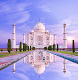 Amazing view on the Taj Mahal in sun light with reflection in wa