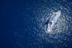 Amazing view to Yacht sailing in open sea at windy day. Drone view - birds eye angle.  Stock Images