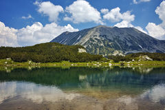 Amazing view of Todorka Peak and reflection in Muratovo lake, Pirin Mountain Royalty Free Stock Images