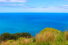 Amazing view of Tyrrhenian sea taken from Rocca di Cefalu, Sicily, Italy. Captured with green grass and plants from the rocks. Above the beautiful bay stock photo