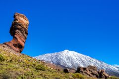 Amazing view of unique Roque Cinchado rock formation with famous. Pico del Teide in the background on a sunny day, Teide National Park, Tenerife, Canary Islands Royalty Free Stock Photo