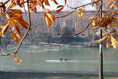Amazing view of the Valentino castle with canoes sailing on the river PO. Turin, Piemonte, Italy Stock Images