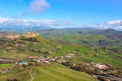 Amazing view of village Calascibetta in Sicily taken with adjacent green hilly landscape. Photographed from the view point in Enna. Beautiful landscapes in royalty free stock image