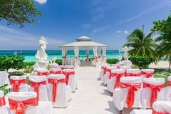 Amazing view of wedding ceremony event decorated gazebo against blue sky and ocean background. Beautiful amazing view of wedding ceremony event decorated gazebo royalty free stock photo