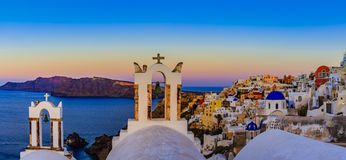 Amazing view with white houses in Oia village. Royalty Free Stock Photos