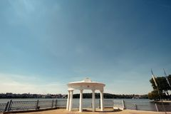 Amazing view on white luxury stone arch on pier on background of. Sunny lake Royalty Free Stock Images