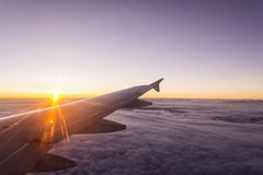 Amazing view from the window plane. Evening flight on twilight sky, amazing view from the window plane stock photography