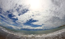 Amazing views of the blue sea with the sky full of clouds Royalty Free Stock Image