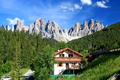 Amazing views of the Odle Mountains in Dolomites, Italy. The Funes valley is overlooked by the wonderful Odle Group in the background, a jagged chain of rocky stock images