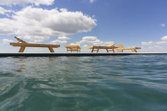 Amazing views over the pool area with wooden sun loungers. Stock Image