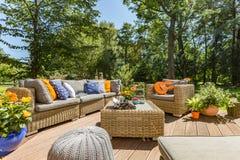 Amazing villa patio idea. Spacious villa patio with comfortable stylish rattan furniture set Royalty Free Stock Images