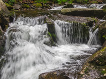 Amazing waterfall in deep forest landscape. Stock Photo