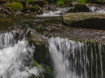 Amazing waterfall in deep forest landscape. Stock Image