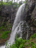 Amazing waterfall in deep forest landscape. Royalty Free Stock Image