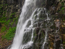 Amazing waterfall in deep forest landscape. Stock Images