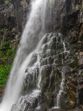 Amazing waterfall in deep forest landscape. Royalty Free Stock Photography