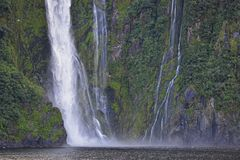 Amazing Waterfall in Milford Sound stock photo