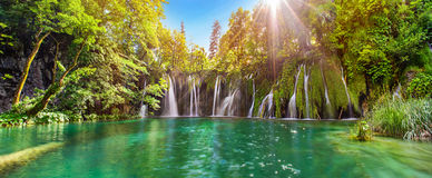 Amazing waterfall panorama in Plitvice Lakes National Park, Cro. Atia, Europe. Majestic view with turquoise water and sunset sunny beams, travel destinations stock photos