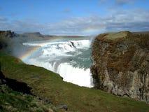 Amazing waterfall with rainbow. Iceland Royalty Free Stock Image
