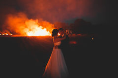 Amazing wedding couple near the fire at night Royalty Free Stock Images