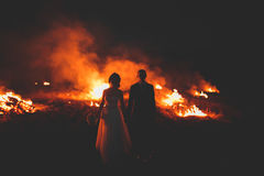 Amazing wedding couple near the fire at night Royalty Free Stock Photos
