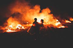 Amazing wedding couple near the fire at night Royalty Free Stock Photography