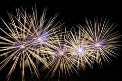 Amazing white-blue fireworks on black background.  Stock Image